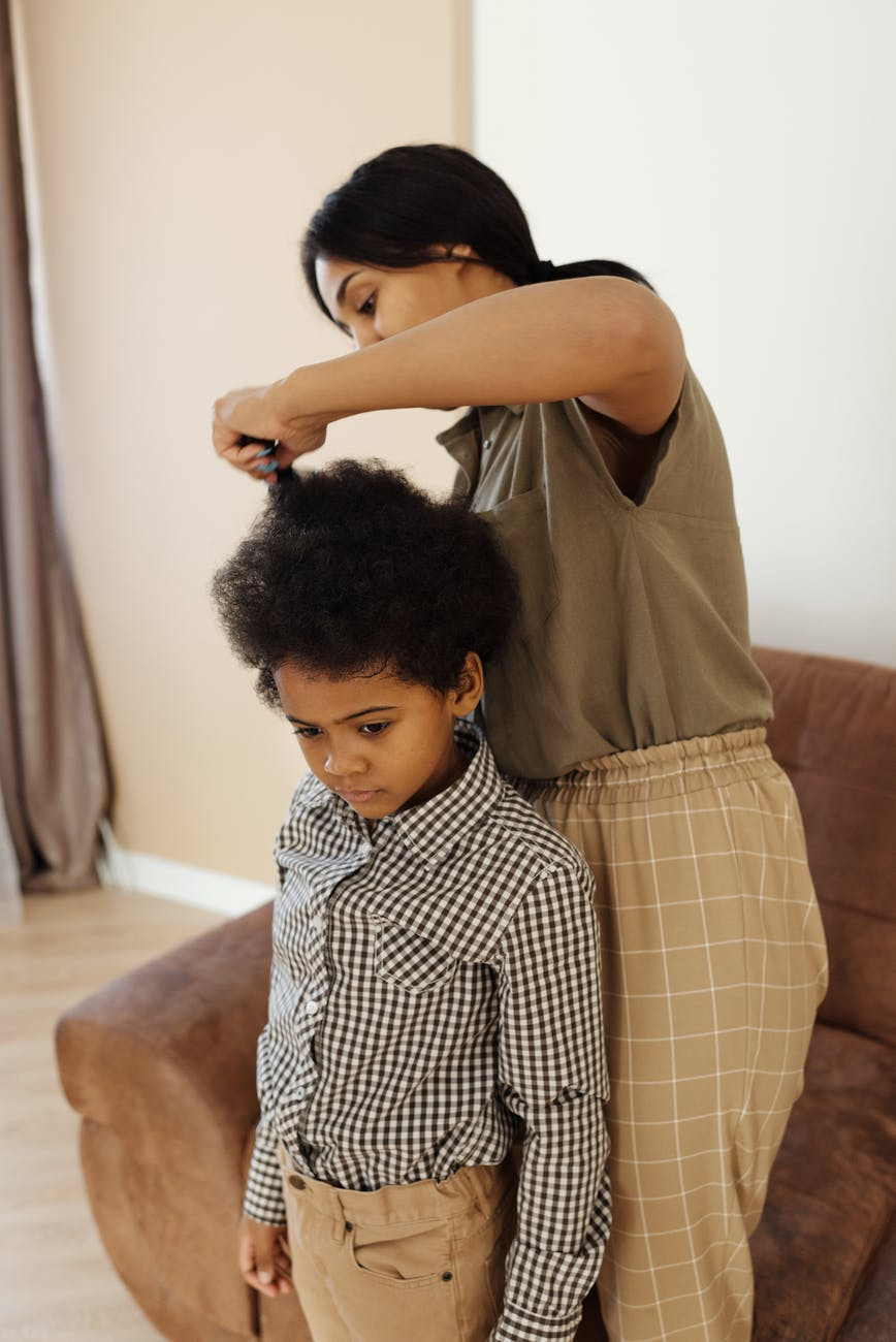 mother helping her son to get changed